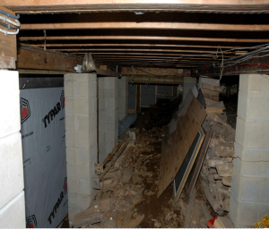 The creepy crawl space where the crate had been hidden